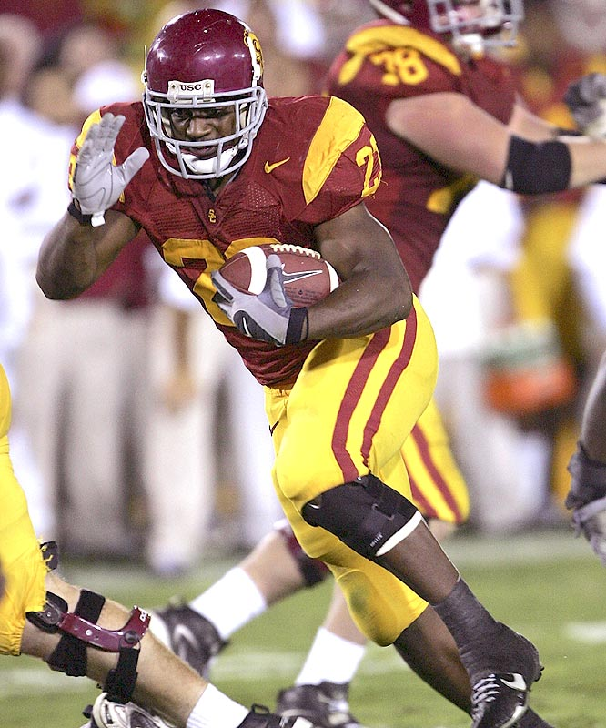 Chauncey Washington ran for 119 yards and touchdowns of 5, 3 and 42 yards as the Trojans cruised past Oregon.