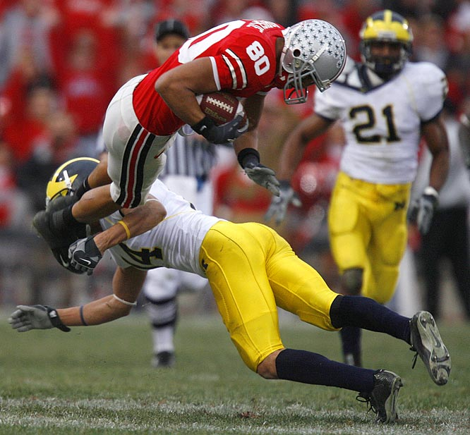 Split end Brian Robiskie of Ohio State was upended by Morgan Trent, a Michigan cornerback.
