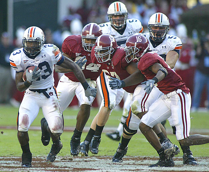 Kenny Irons had 85 yards and a touchdown as Auburn won its fifth straight Iron Bowl, the first time the Tigers have won five in a row since 1958.