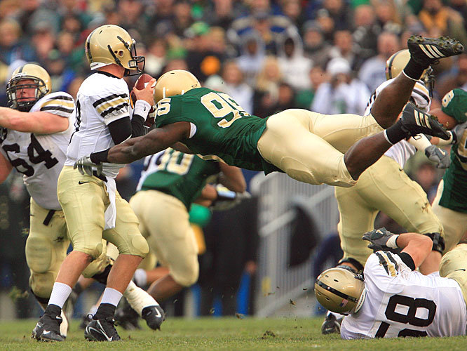 Defensive end Victor Abiamiri helped the Irish win in their green jerseys for the first time since 1985, when Notre Dame came out in the first half wearing blue against USC and at halftime switched to green in a 37-3 victory.