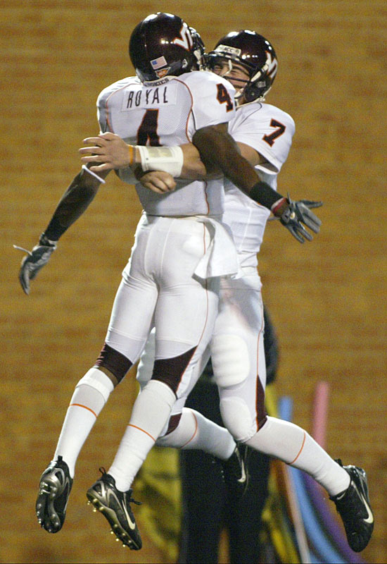 Eddie Royal and Sean Glennon celebrate after the pair connected on a 49-yard touchdown in the first quarter of the Hokies' win.