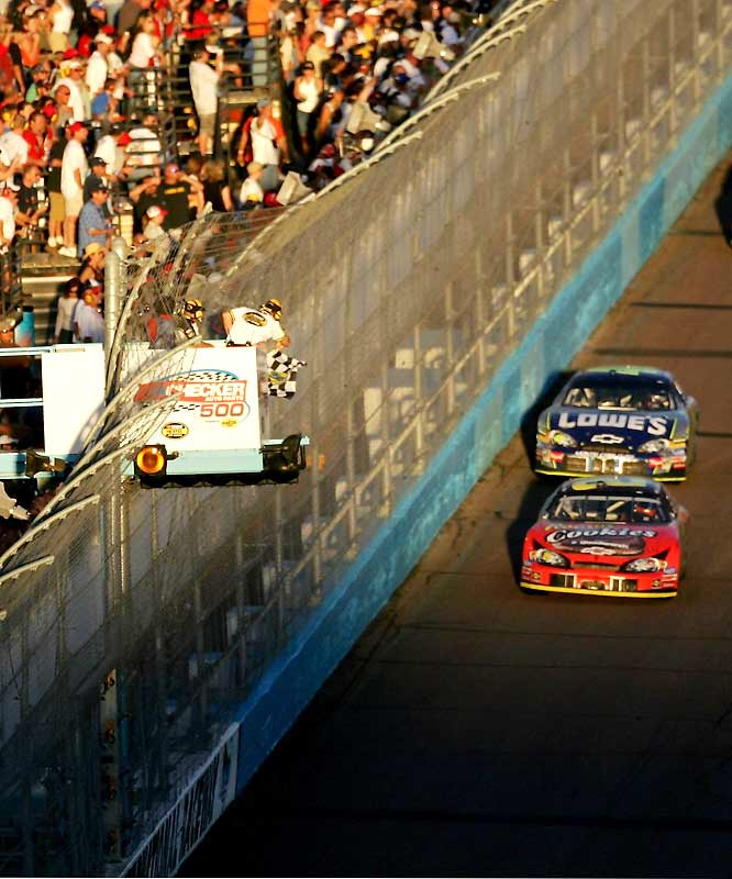 After winning the Spring race in the Southwest, Harvick came through with his best performance since New Hampshire, leading all but 70 laps en route to a Phoenix season sweep. Unfortunately for him, Jimmie Johnson stood focused in his rear view mirror; keeping his competition in sight all day (in photo). Johnson expanded his points lead to 63 with one race remaining, making him an overwhelming favorite to finally claim the title he's coveted for years. Jeff Gordon, Jeff Burton, Mark Martin, Kasey Kahne and Kyle Busch become officially eliminated from Chase contention.