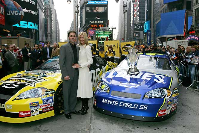 Jimmie Johnson and his wife, Chadra -- along with their newest acquisition, the Nextel Cup trophy -- strike a pose in the heart of New York.