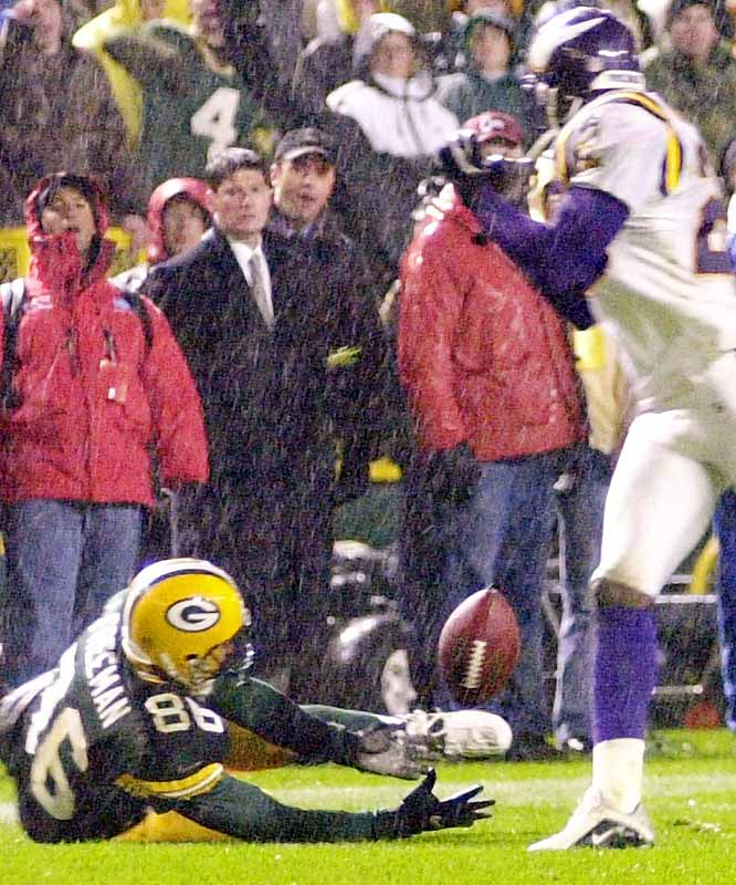 With the game tied at 20, the Vikings missed a 32-yard field goal on a rain-drenched field at the end of regulation against archrival Green Bay in a crucial Monday-night showdown. The game went to overtime and the Packers got the ball first. On third-and-four from the Minnesota 43, Green Bay's Brett Favre lofted a pass to Antonio Freeman, who got tangled with defender Cris Dishman and hit the ground. The ball bounced off Dishman, and Freeman, with his back on the ground, grabbed it and watched Dishman run by. Still untouched, Freeman got up and ran 15 yards into the end zone for the game-winning score.