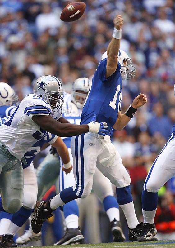 Peyton Manning threw for 254 yards and two touchdowns, but the Cowboys' defense took control by forcing three turnovers, handing the Colts their first loss of the season.