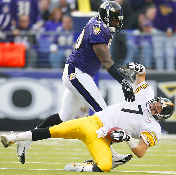 Baltimore defensive end Trevor Pryce takes down Ben Roethlisberger, who was sacked nine times for a total of 73 yards lost, matching a Ravens franchise record.  The Steelers were shut out for the second time this season as Baltimore won its fifth straight.