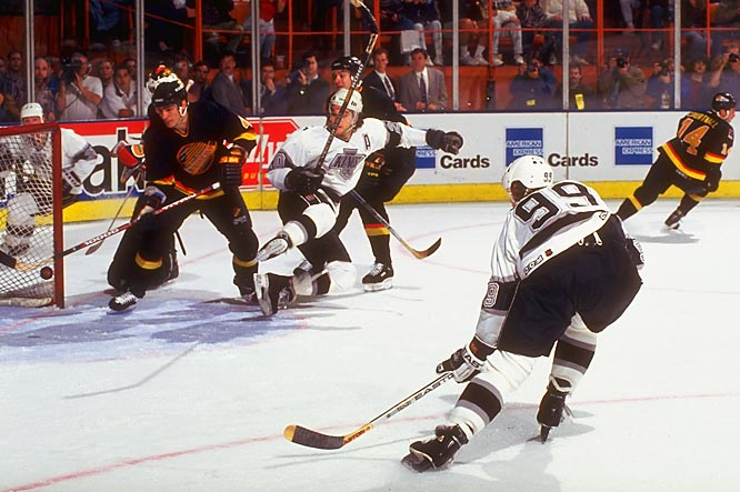 On May 24, 1994, Gretzky beat Canucks' goalie Kirk McLean to score his 802nd goal, breaking the career mark of his childhood hero, Gordie Howe. Gretzky's famous 99 was a homage to Howe, who wore 9.