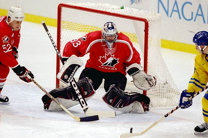 A proud Canadian, Roy represented his country at the 1998 Winter Olympics in Nagano, Japan. Here, Roy stops Sweden's Daniel Alfredsson in round-robin action. Team Canada failed to reach the gold-medal game when Roy was beaten by Robert Reichel of the Czech Republic in a shootout, and then fell to Finland in the bronze medal contest.