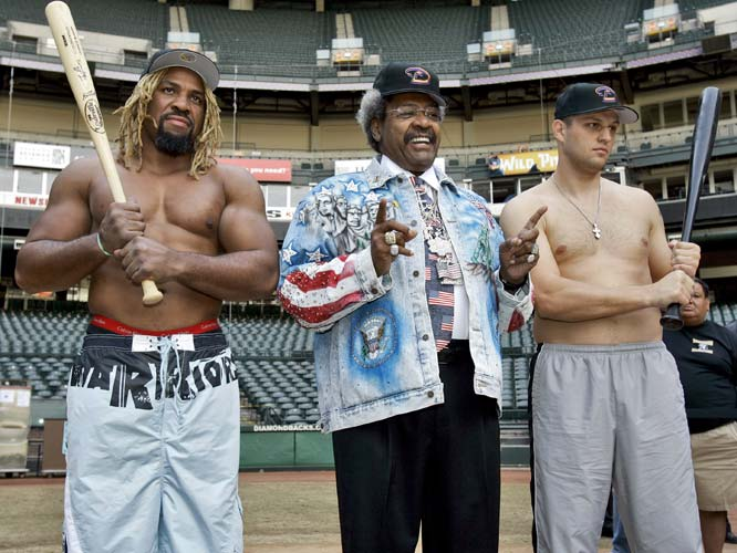 Apparently Sergei Liakhovich, right, Shannon Briggs, left, and Don King weren't aware that the baseball season is over. The pair will fight Saturday for the WBO World Heavyweight Championship in Phoenix.