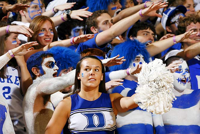 A cheerleader joined the Duke fans while encouraging the Blue Devils in their battle with the Hoyas.