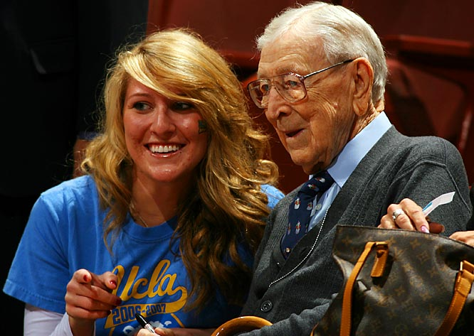 At 96, John Wooden still attracts admirers as he watches UCLA's 65-62 victory over Texas A&M at the Classic bearing his name.
