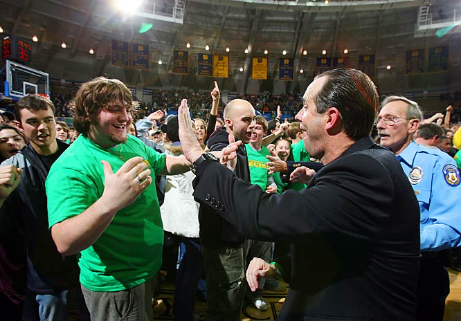 Notre Dame coach Mike Brey high-fives a fan, who may be looking for more, following a big win over Alabama.