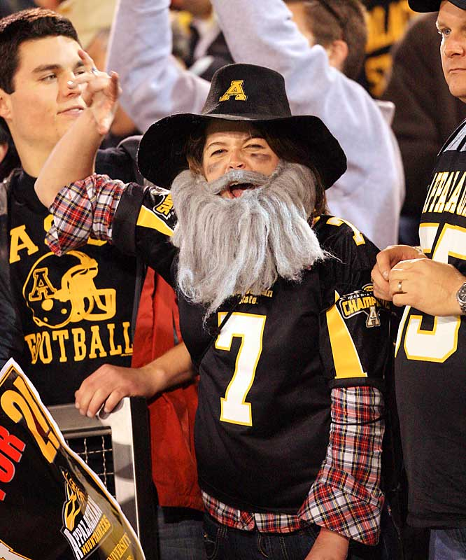 Another excited Appalachian State student, this one in full Mountaineer getup, cheers on his team.