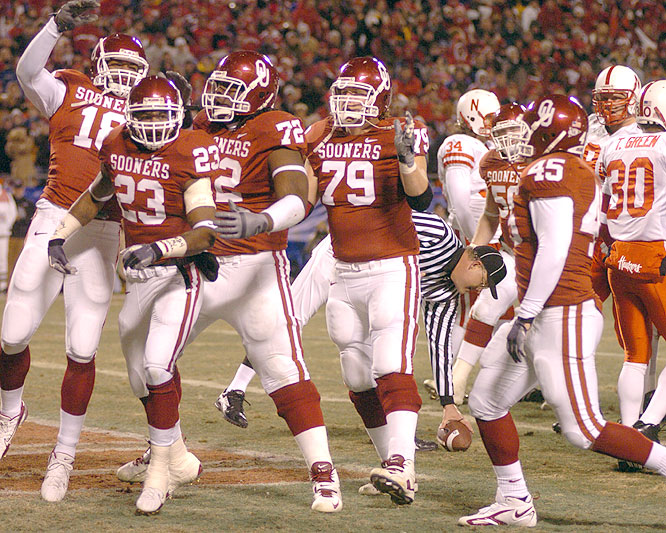 Allen Patrick (23) ran for 35 yards and a touchdown as the Sooners won the Big 12 title, earning a trip to the Fiesta Bowl.