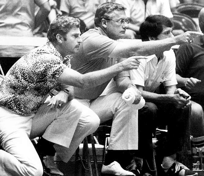 Before Knight became a legendary figure, Fred Taylor (center) coached Knight at Ohio State. Inducted into the Naismith Memorial Hall of Fame for his contributions to the game, Taylor's most enduring product may have been Knight, who Taylor used sparingly during the Buckeyes' winning run to the 1960 NCAA championship. Here he assists Knight during the 1979 Pan American Games in San Juan, Puerto Rico.