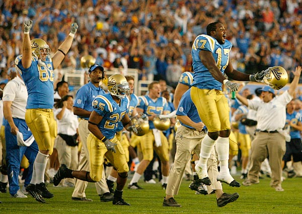 Defensive end Justin Hickman (17) and the rest of the UCLA players celebrated on the field at the Rose Bowl in Pasadena after the Bruins defeated USC 13-9 to knock the Trojans out of consideration for the BCS Championship Game against Ohio State on January 8.