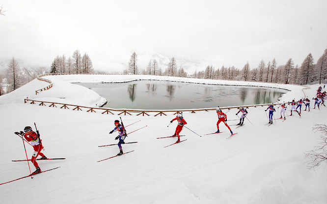 Skiers in the Biathlon Men's 15 km Mass start their long journey at the 2006 Winter Games.