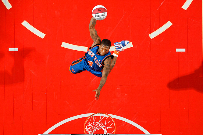New York Knicks rookie guard Nate Robinson attempts a dunk during the 2006 NBA All-Star Slam Dunk contest, which he won.