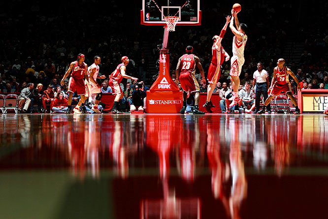 Houston center Yao Ming is reflected on the baseboards as he takes a shot against the Cleveland Cavaliers at home. Yao scored 24 points in Houston's 81-63 win.