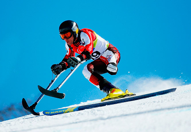 Austria's A. Schmid in action during standing men's downhill at the '06 Turin Winter Paralympics.
