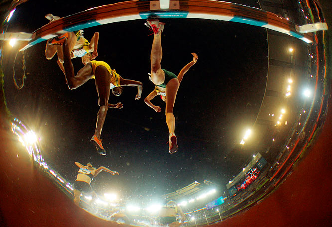 Athletes compete during the women's steeplechase final of the Melbourne Commonwealth Games.
