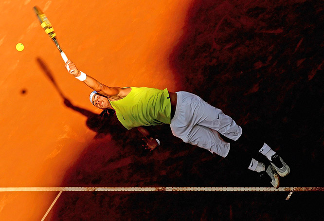 Rafael Nadal serves against Gael Monfils during the ATP Masters Series in Italy. Nadal went on to defeat Roger Federer in the final.