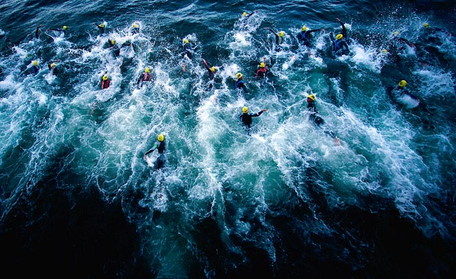Competitors swim in a pack at the beginning of the Escape from Alcaltraz Triathlon in San Francisco.