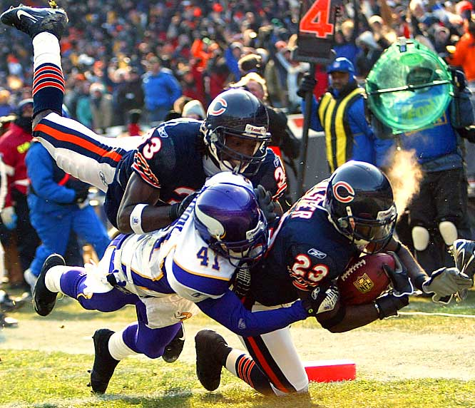 Devin Hester dives into the end zone for a touchdown on a 45-yard touchdown return against Minnesota, tying an NFL record with his fourth touchdown return of the season.