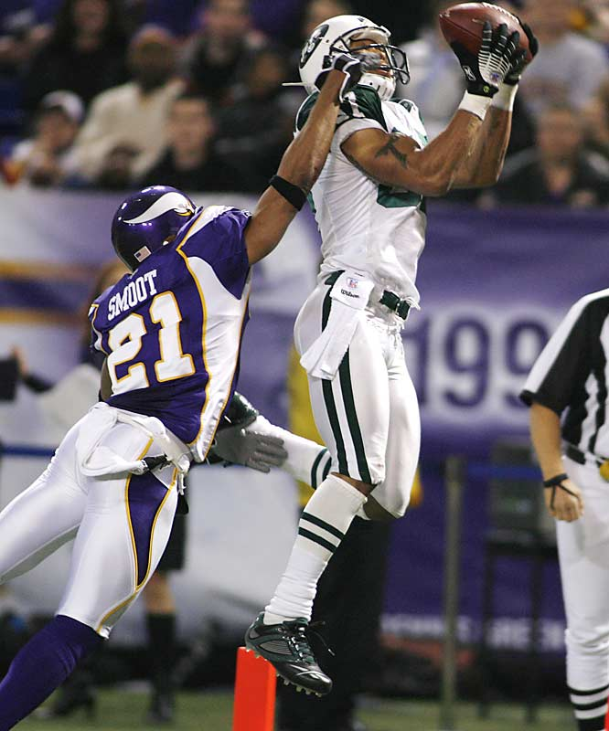Laveranues Coles hauls in a 21-yard touchdown pass against Minnesota cornerback Fred Smoot in the second quarter.  Coles had 12 catches for 144 yards as quarterback Chad Pennington threw for a career-high 339 yards.