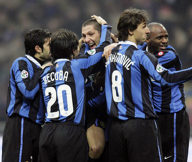 Inter players mob Marco Materazzi (middle) after the defender scored on a spectacular bicycle kick in the 49th minute to open the scoring against Messina. The Nerazzurri's victory was their ninth in Serie A, equaling a club record.