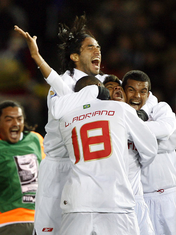 Backup striker Luis Adriano (18) stunned European champions Barcelona in the title match of the FIFA Club World Cup, scoring the game's only goal in the 82nd minute. Brazil's Internacional became the second straight South American champ to win the tournament of the world's regional champions.