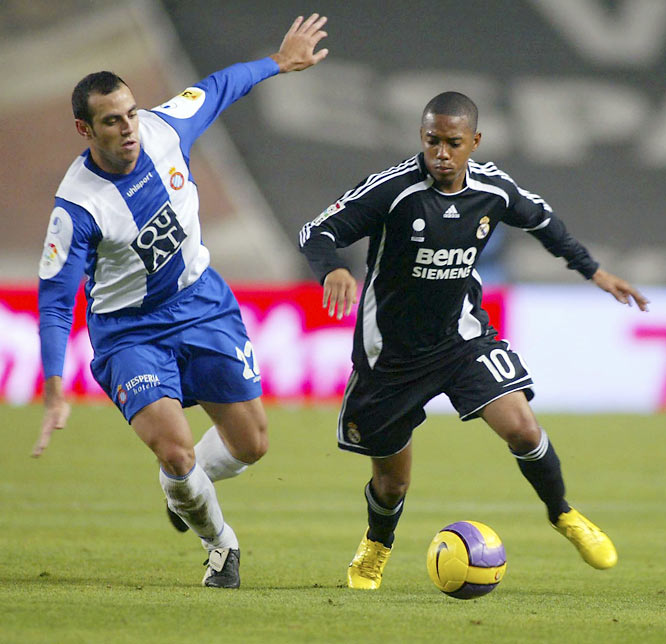 Robinho (right) controls the ball against Espanyol's Moises Hurtado during Real's victory in Barcelona. Ruud van Nistelrooy scored the game's only goal in the 50th minute, helping Real stay a point back in Spain.