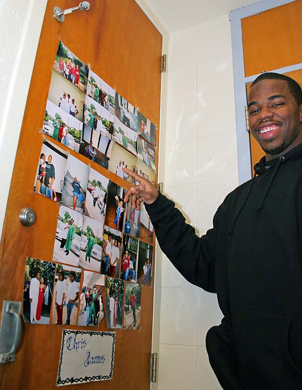 "CJ's closet door is decorated with photos of family, graduation and prom. He says the pictures -- especially ones of his younger twin sisters -- were among the few things he wouldn't have made it in college without. ""I just need my family,"" CJ says. ""That's all I need."""