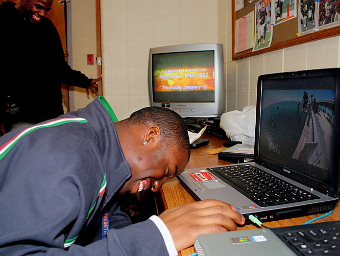 "Teammate Vontae Davis watches Jackass Number Two on CJ's computer. Vontae, a starting cornerback for the Illini, is one of several football players living in the same dorm. ""Everybody on the team stays by a bathroom,"" Juice says. ""I don't know why that is, but I noticed that."""