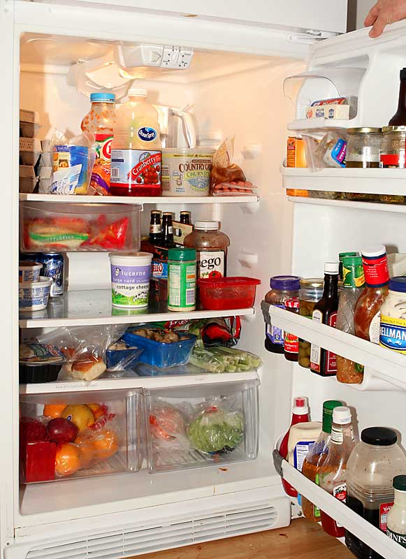 "The fridge is stocked with the usual milk, cheese and leftovers that teammate and housemate Nick Hayes yells look like ""throw up in a bag""."