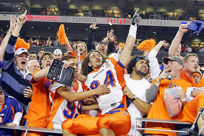 Boise State's Aiona Key celebrates with fans after the Broncos incredible comeback win over Oklahoma, 43-42, in the Fiesta Bowl.
