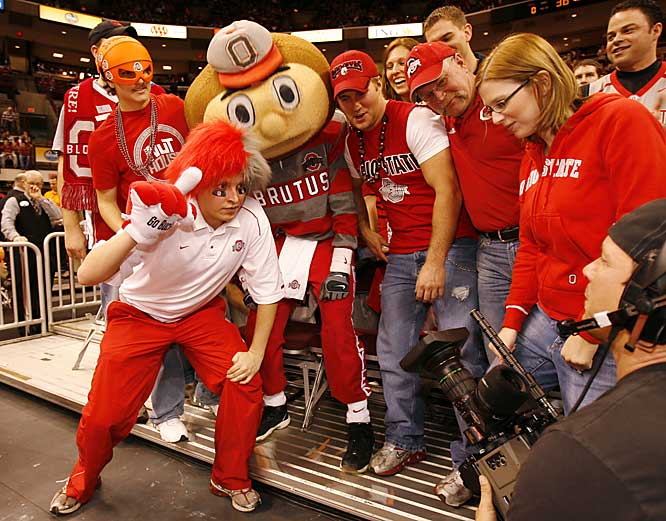 Ohio State fans pose with Brutus Buckeye before the Buckeyes 68-66 victory over Tennessee on Saturday.