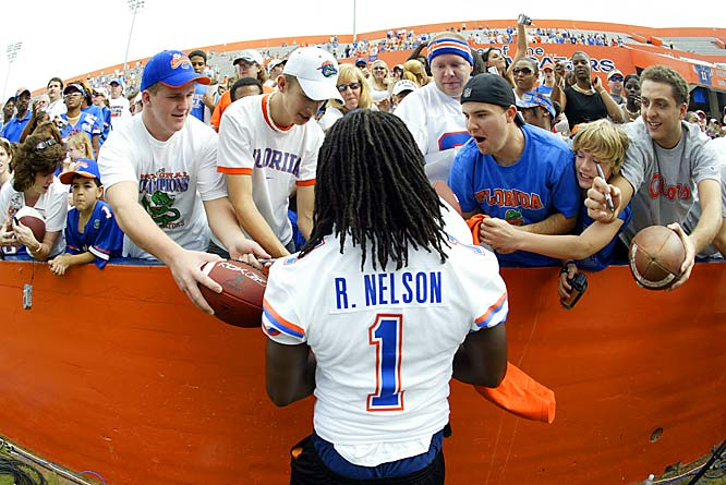 Florida defensive back (1) Reggie Nelson signs autographs for fans during the team's national championship celebration last Saturday.