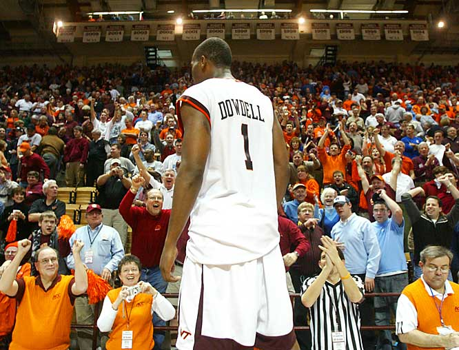 Zabian Dowdell (1) stands on the scorers' table after Virginia Tech's upset over UNC.