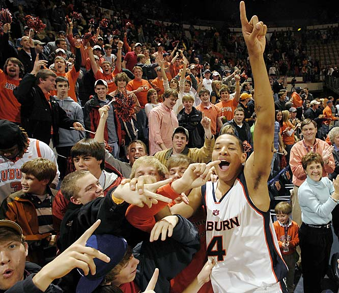 Auburn's Lucas Hargrove celebrates with fans after the Tigers upset Tennessee, 83-80, on Wednesday.
