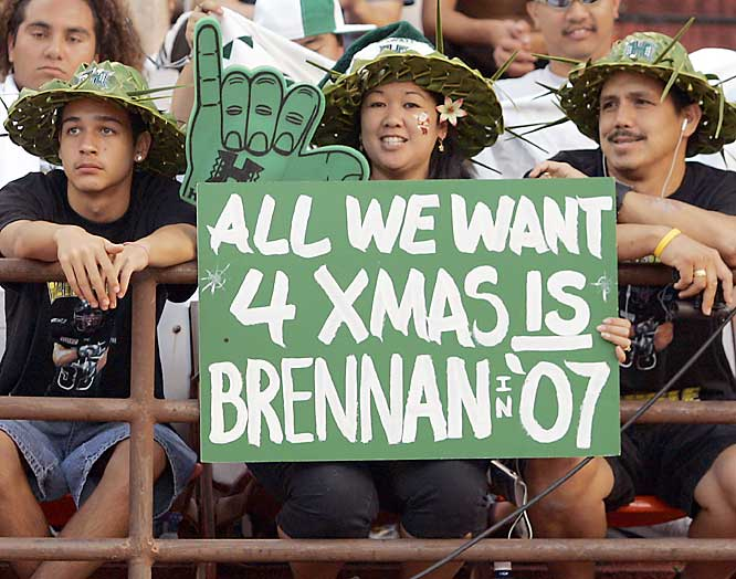 Hawaii football fans show their love for QB Colt Brennan during the Hawaii Bowl. The QB responded with 559 passing yards and five TDs as the Rainbows defeated ASU, 41-24.