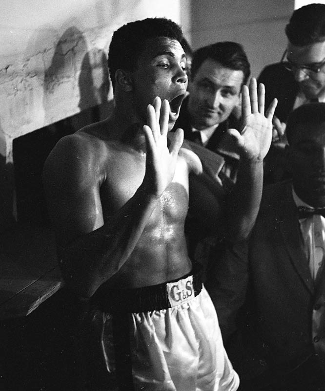 In recognition of Muhammad Ali's 65th birthday, photographer Neil Leifer has released some of previously unpublished photos of the former heavyweight champ from a 1963 win against Doug Jones and the '64 classic against Sonny Liston.<br><br> Here Ali -- then known as Cassius Clay -- hams it up with reporters after the Jones fight.