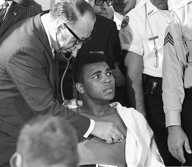 Clay getting checked out before the Liston bout in Miami.