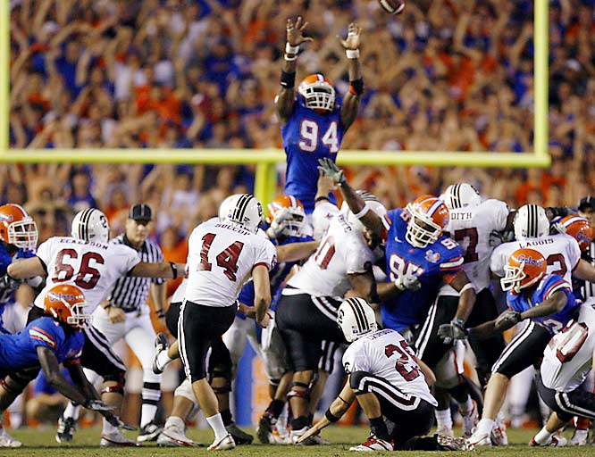 Jarvis Moss (94) blocks a 48-yard field goal as time expires (his second blocked kick of the game) and Florida escapes a huge scare from former Gator coach Steve Spurrier's team.