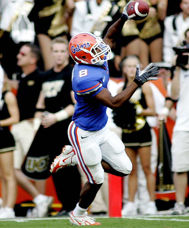 Chris Leak connects on 19 of 29 pass attempts for a career-high 352 yards and four touchdowns. Freshman sensation Percy Harvin (pictured) scores his first touchdown, taking a crossing route 58 yards to the house.