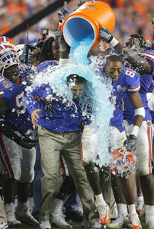 Head coach Urban Meyer gets the traditional Gatorade shower with the game well in hand.