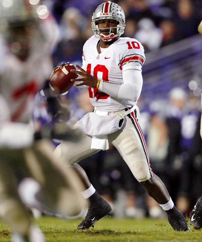 Ohio State accumulates a season-high 54 points, as Smith throws four touchdown passes.