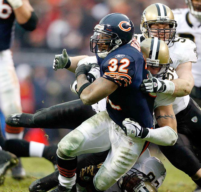 Cedric Benson carries two defenders on a carry up the middle.
