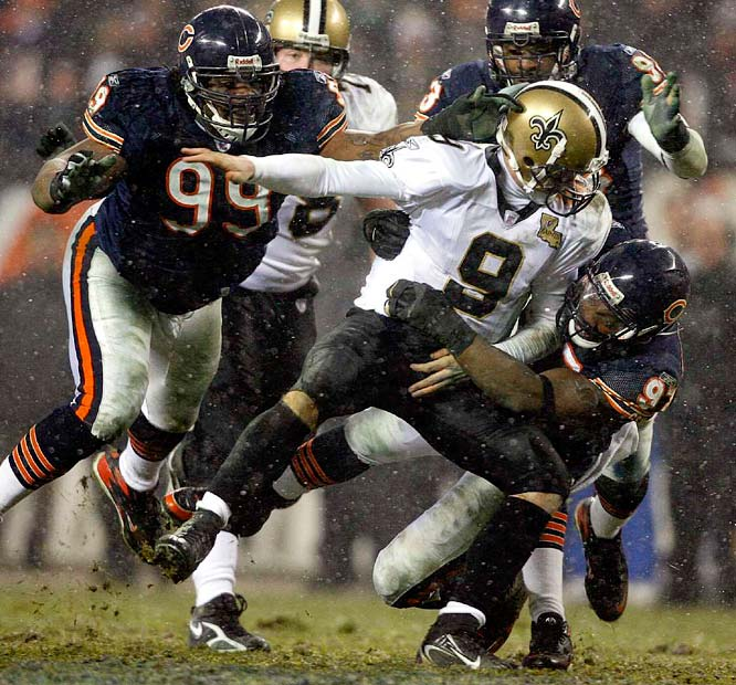 Bears defensive tackle Tank Johnson (99) and defensive end Mark Anderson pile up on Brees in the fourth quarter.