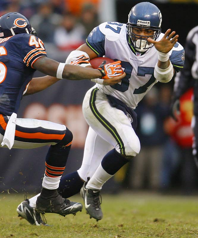 Shaun Alexander had 26 carries for 108 yards and two touchdowns against Chicago.